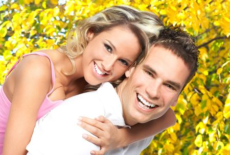 yellow teeth: Young  happy smiling couple in love in park
