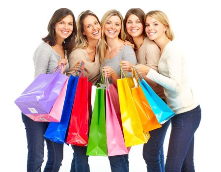 Happy shopping women. Isolated over white background  photo
