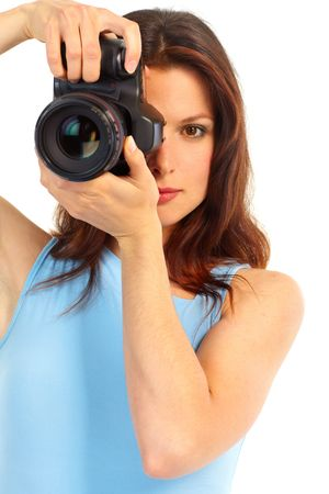 Young woman with photo camera. Isolated over white background  photo