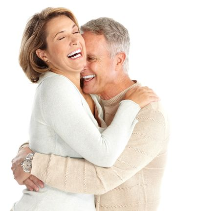 Happy elderly couple in love. Isolated over white background Stock Photo - 5770934