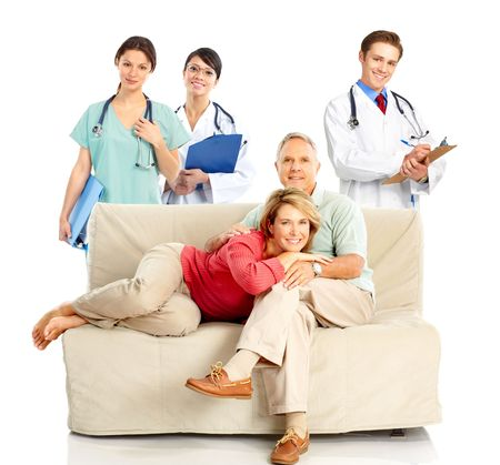 Smiling medical doctors with stethoscope and elderly couple  photo
