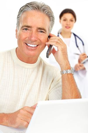 Smiling medical doctor with stethoscope and smiling elderly man  photo
