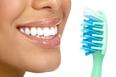 Smiling  young woman with healthy teeth and a tooth-brush  photo