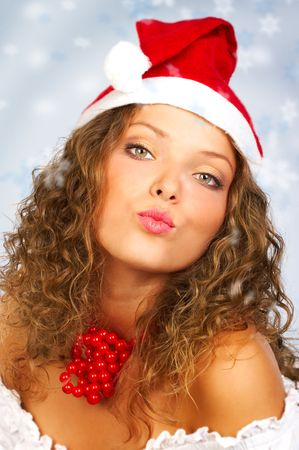 sexy santa girl: Christmas woman in a Santa Cap. Over blue background Stock Photo