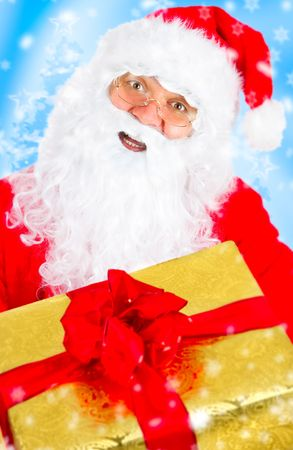 Happy Christmas Santa with gift. Over blue background photo