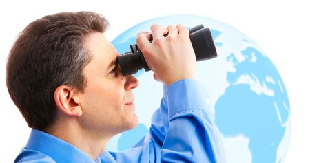 businessman  with binoculars looking at the globe  photo