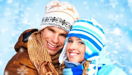 Young happy couple. Over blue background