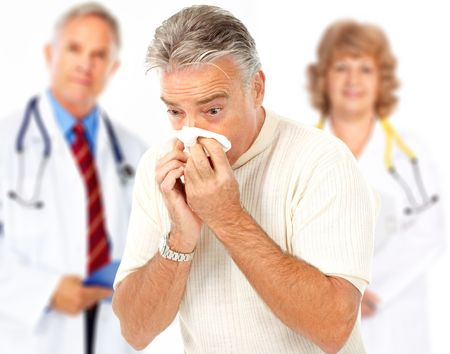grippe: Doctors and man having the flu. Isolated over white background