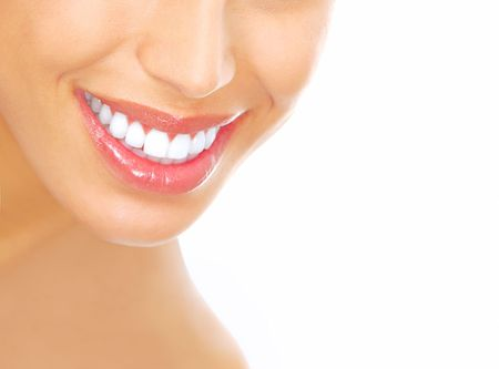 tooth whitening: Beautiful young woman teeth. Isolated over  white background