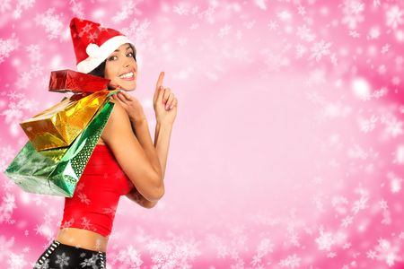 boxing day sale: Christmas shopping smiling Santa  woman . Over red  background
