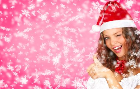 Christmas woman in a Santa Cap. Over red background   photo