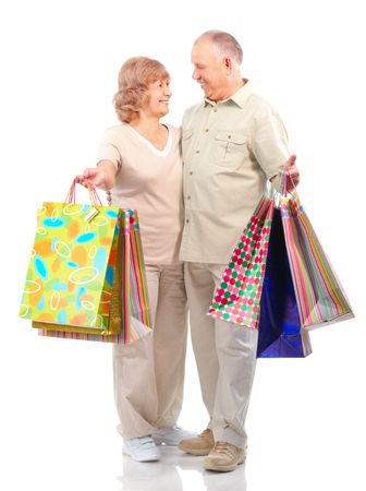 Happy shopping senior couple. Isolated over white background  photo