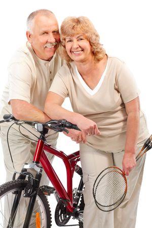 Active senior couple. Isolated over white background  photo