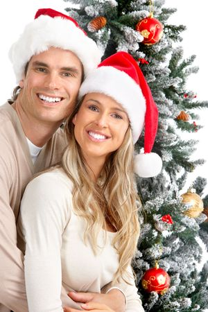 Smiling young couple near a Christmas tree. photo