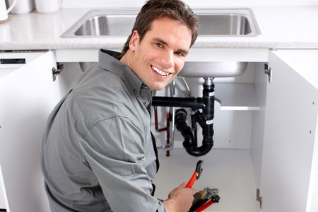 Young plumber fixing a sink  Stock Photo - 7041700