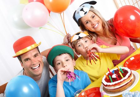 children party: Happy family . Father, mother and children celebrating birthday at home  Stock Photo