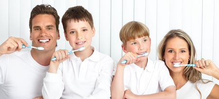 brush teeth: Happy family. Father, mother and children with toothbrushes.   Stock Photo