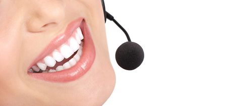 Beautiful  call center operator with headset. Isolated over white background Stock Photo - 7184546
