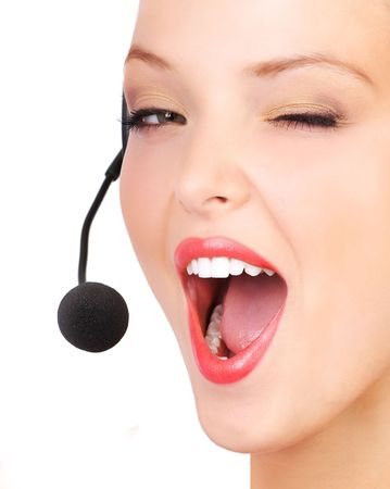 Beautiful  call center operator with headset. Isolated over white background Stock Photo - 7184541