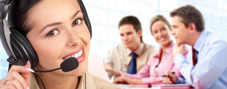 hotline: Beautiful  call center operator with headset. Isolated over white background   Stock Photo