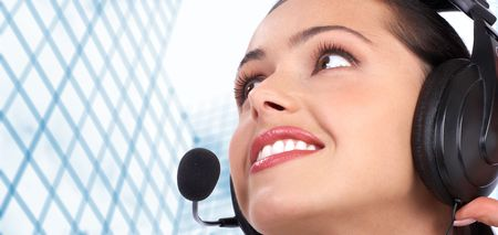 Beautiful  call center operator with headset. Isolated over white background Stock Photo - 7184556
