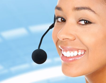 Beautiful  call center operator with headset. Isolated over white background Stock Photo - 7184542