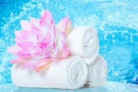 Spa. Towels with lotus flower.  Body care. photo