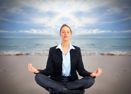 Business woman doing yoga on the beach  Vacation Stock Photo - 20311896