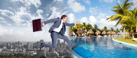 Businessman running on the beach  Summer vacation  Stock Photo