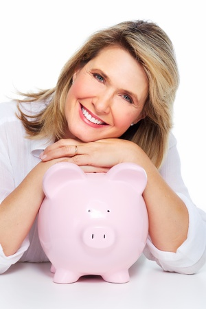 Senior woman with a piggy bank. Isolated on white. Stock Photo - 20311902