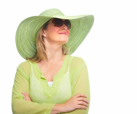 Senior Woman wearing sunglasses and a hat. Summer vacation. photo
