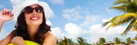 Woman wearing sunglasses and a hat. Summer vacation. Stock Photo - 20311904