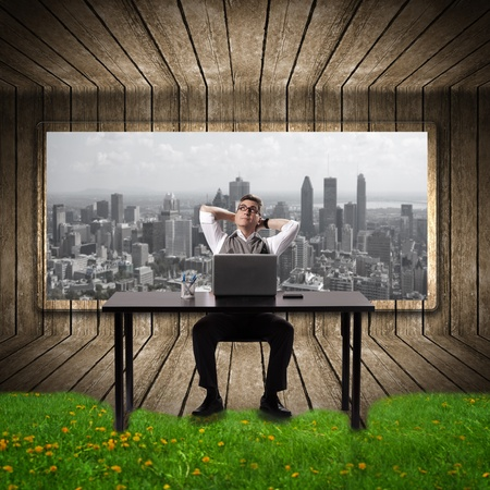 Businessman relaxing in the office. Conceptual background. photo