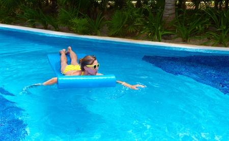 Woman in swimming pool at caribbean resort  photo
