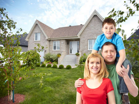home owner: Happy family near new house