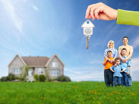 housing estate: Happy family near new house