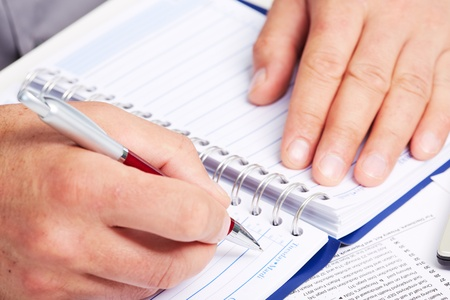 Hand with a pen  photo