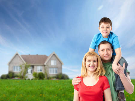 real estate house: Happy family near new house