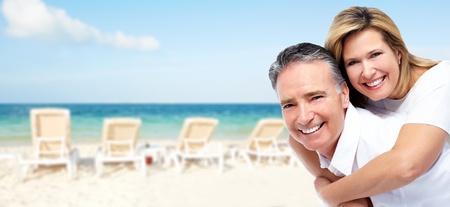 Happy senior couple on a tropical beach  photo