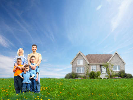 home purchase: Happy family near new house