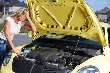 car trouble: Woman near broken car. Auto repair service concept. Stock Photo