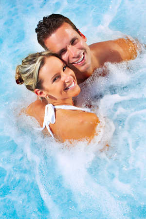 bathtub: Happy couple relaxing in hot tub. Vacation. Stock Photo