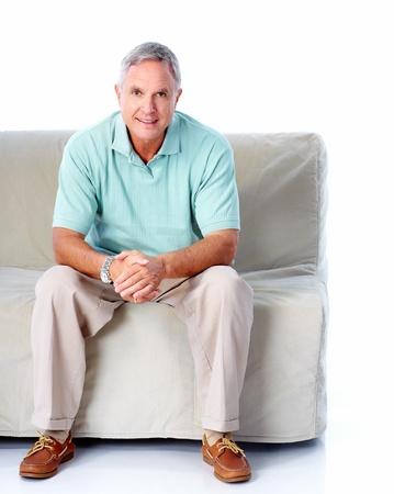 sofa: Elderly man portrait. Isolated on white background. Stock Photo