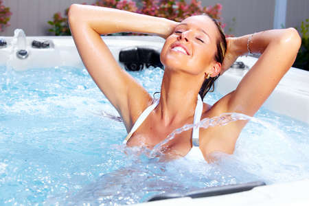 water hottub: Beautiful woman relaxing in a hot tub. Vacation.