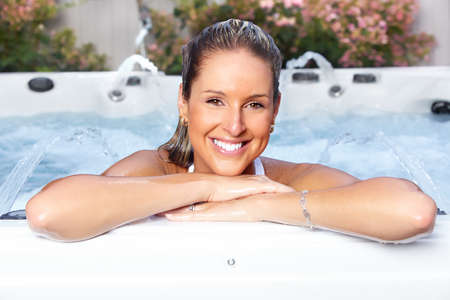 hot tub: Beautiful woman relaxing in a hot tub. Vacation.
