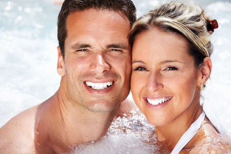 jets: Happy couple relaxing in hot tub. Vacation. Stock Photo