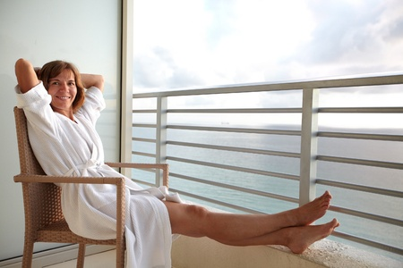 balcony: Woman on a balcony at Miami. Stock Photo