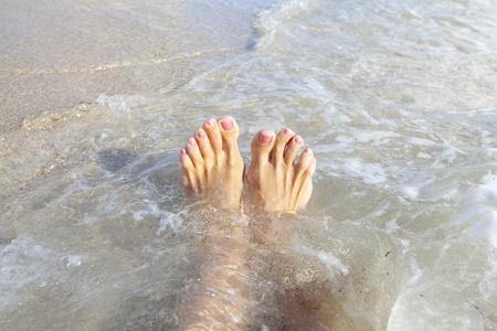 hot legs: Beautiful tropical beach. Caribbean vacation resort. Stock Photo