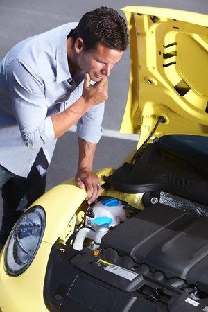 Man near broken car. Auto repair service concept. photo