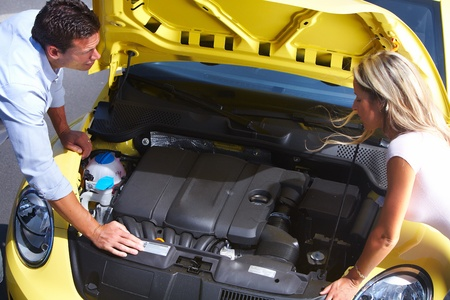 Couple near broken car. Auto repair service concept. photo